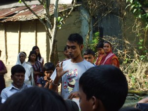 25-year-old Sapan Miah teaches villagers about pneumonia and other health matters. Parathia, South Sunamganj, Bangladesh